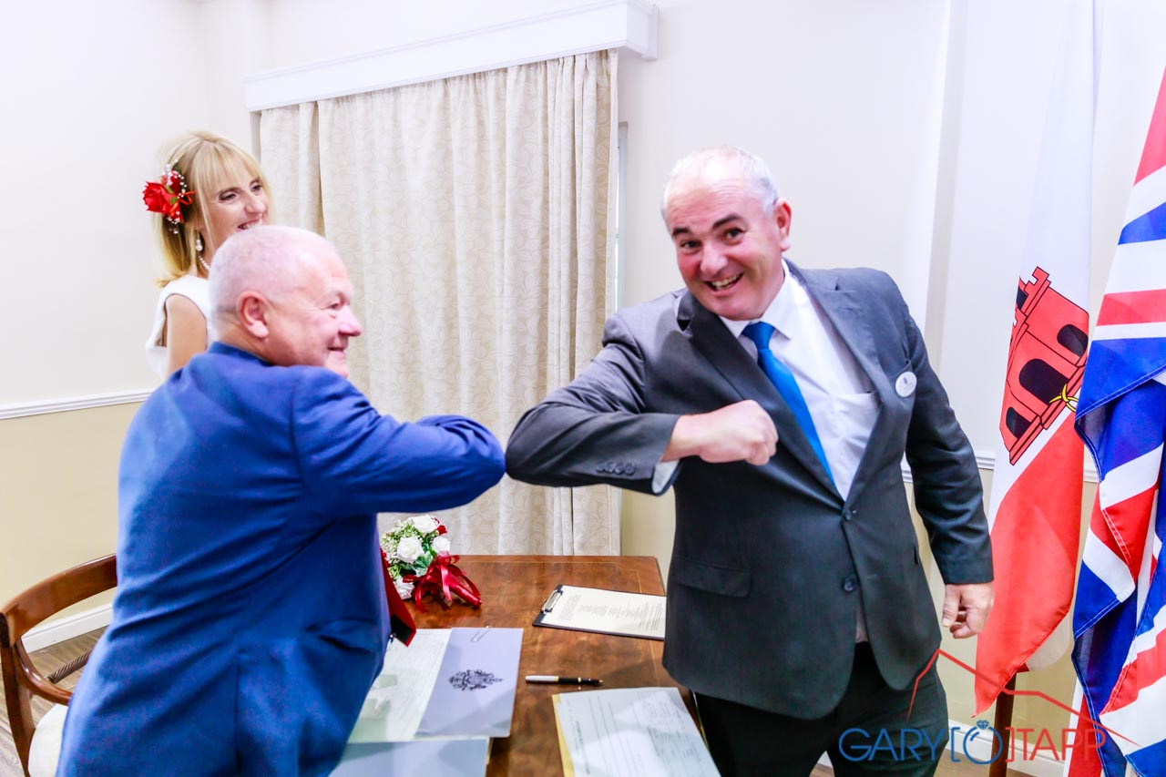 The Registry Office Gibraltar inside ceremony room with Adrian the registrar