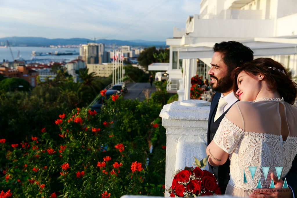 Couple overlooking the bay at The Rock Hotel Gibraltar