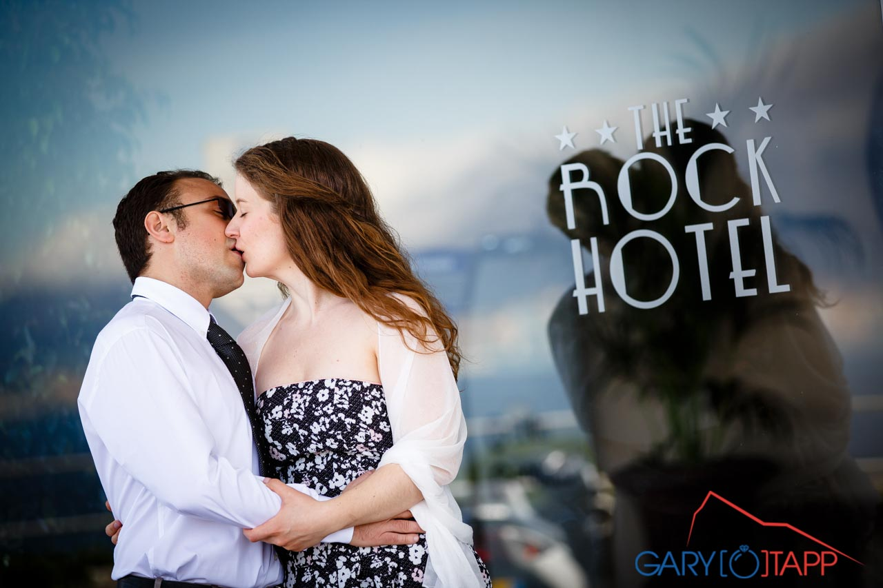 the rock hotel gibraltar wedding bride and groom outside the hotel entrance