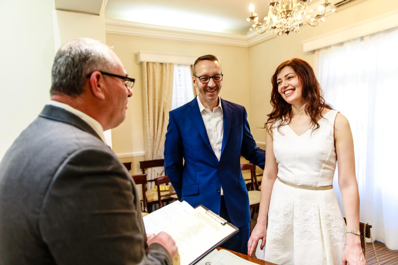 Couple reciting Inside the Gibraltar Registry Office wedding vows