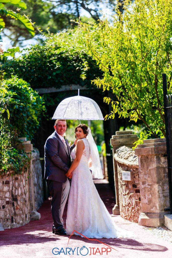 The Botanical Gardens Gibraltar Wedding bride and groom with umbrella