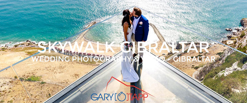 Bride and Groom standing on the Skywalk Gibraltar for thier wedding photos
